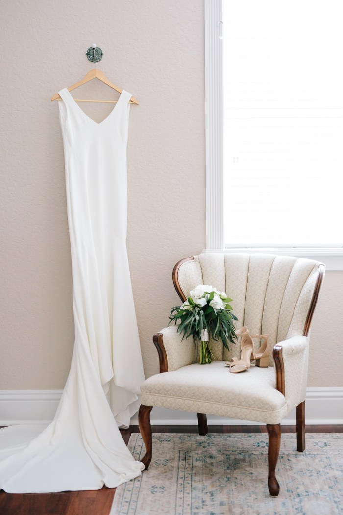 clean v-neck wedding dress with crepe train