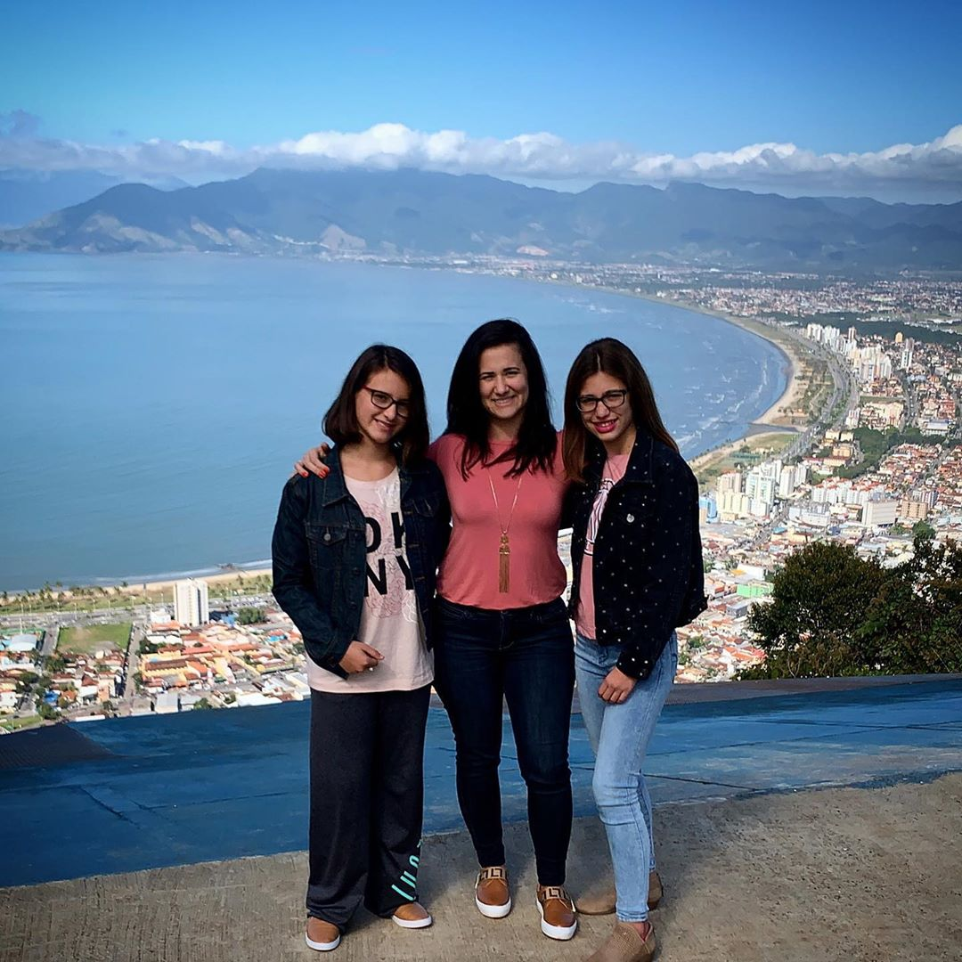 Roberta and her two daughters in Brazil this summer.