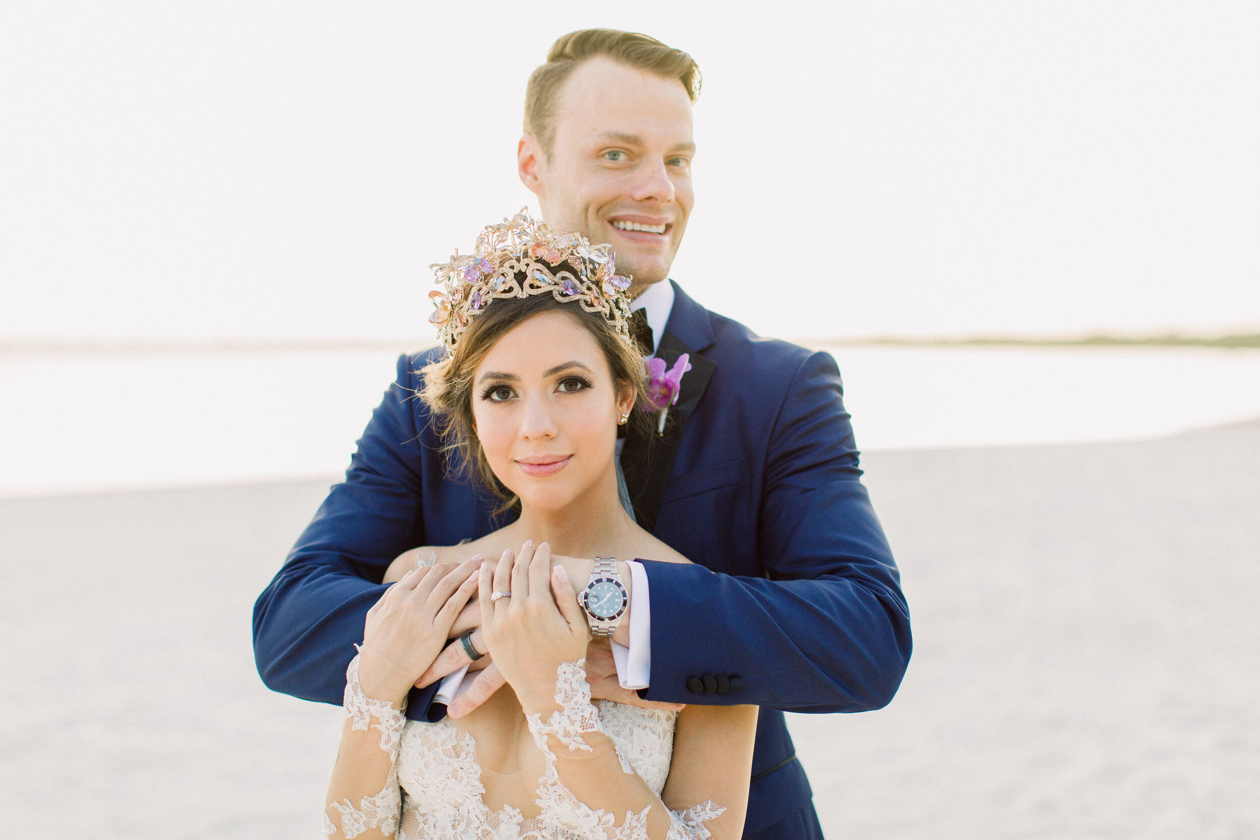 real bride wears lazaro crown by maria elena headpeices to beach destination wedding in cancun