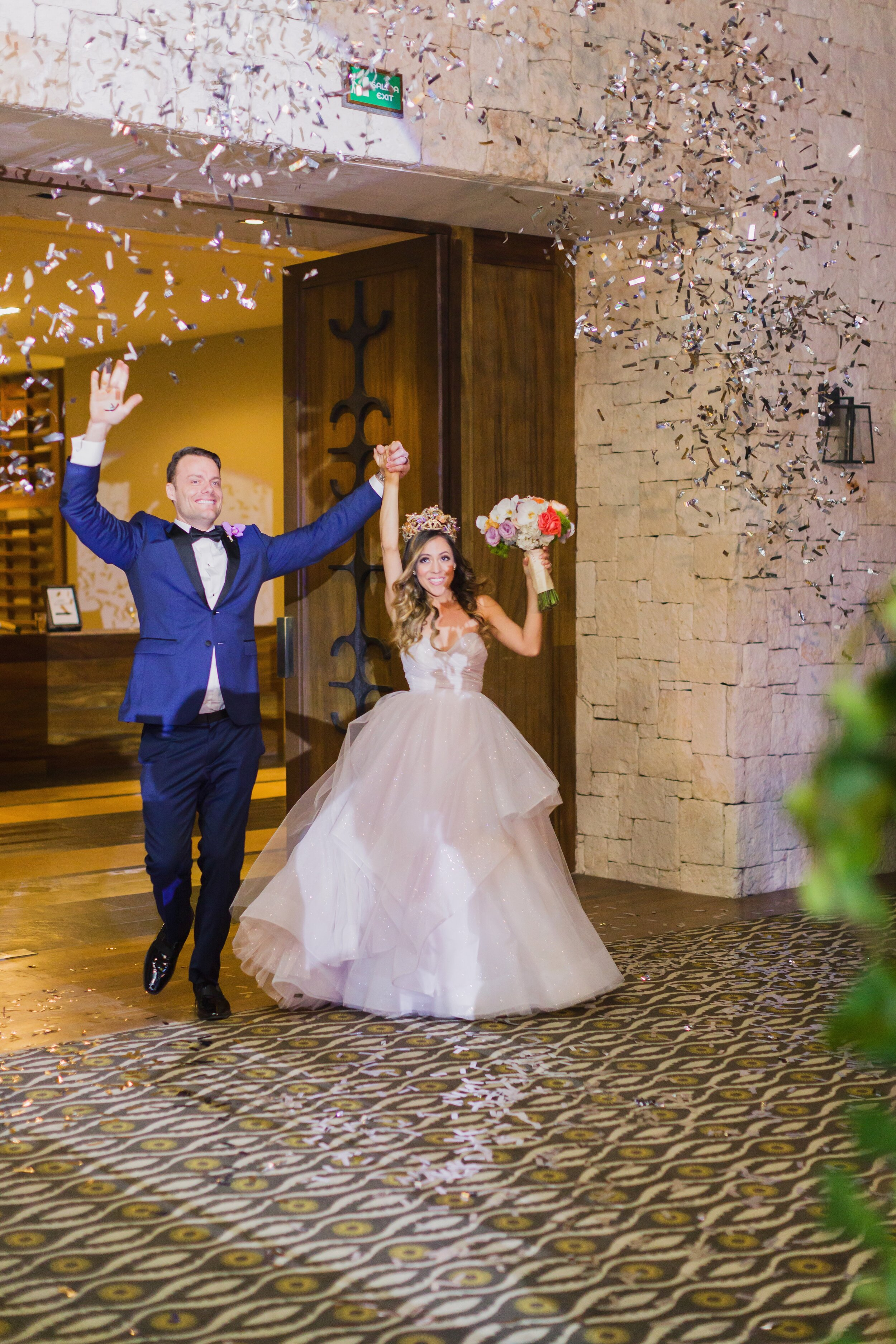 bride wears hayley paige ball gown to nizuc cancun wedding reception
