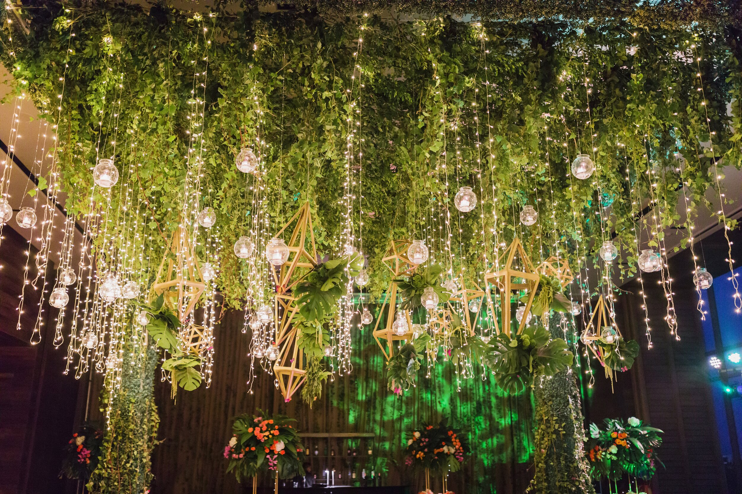 nizuc cancun resort under greenery and lights at wedding reception