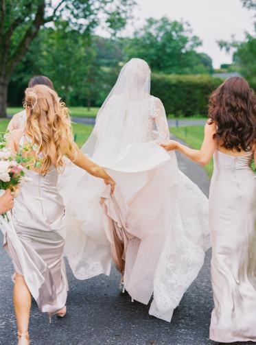 bridesmaids wearing blush dresses from bella bridesmaids