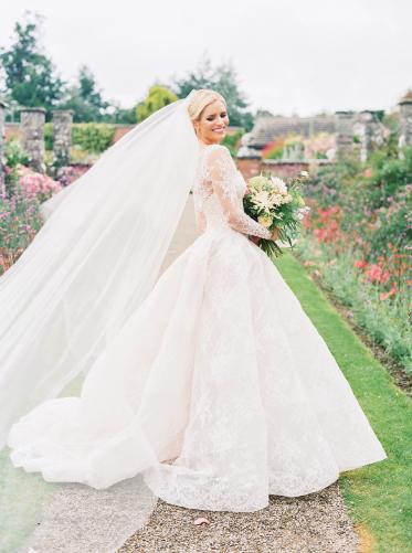 monique lhuillier alexandra ball gown and tulle veil at garden wedding in ireland