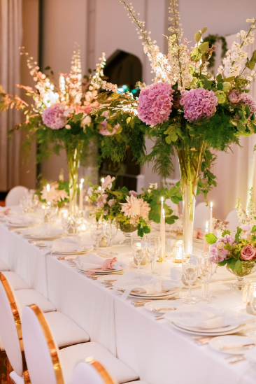 reception decor at ireland wedding with white gold greenery and pink flowers