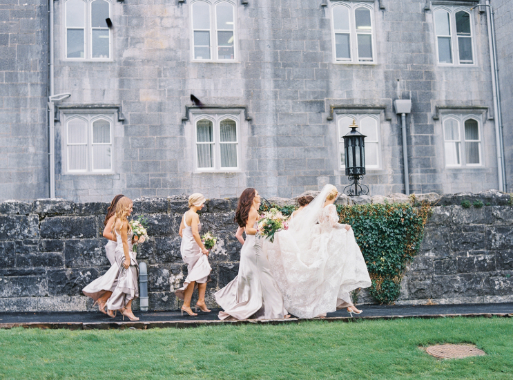 bridesmaid and bride at ennis cathedral in ireland going to wedding