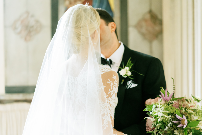 bride wearing lace long sleeve ball gown by monique lhuillier at wedding in ireland