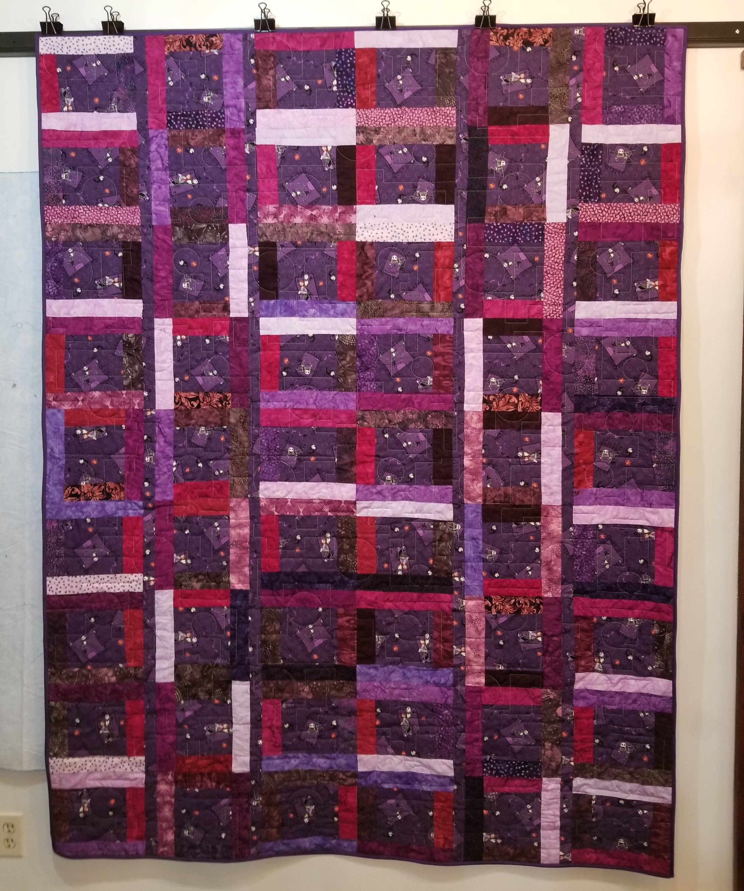 If you look closely, you will see the purple binding used to finish this quilt.  A perfect compliment that shows up better in person.