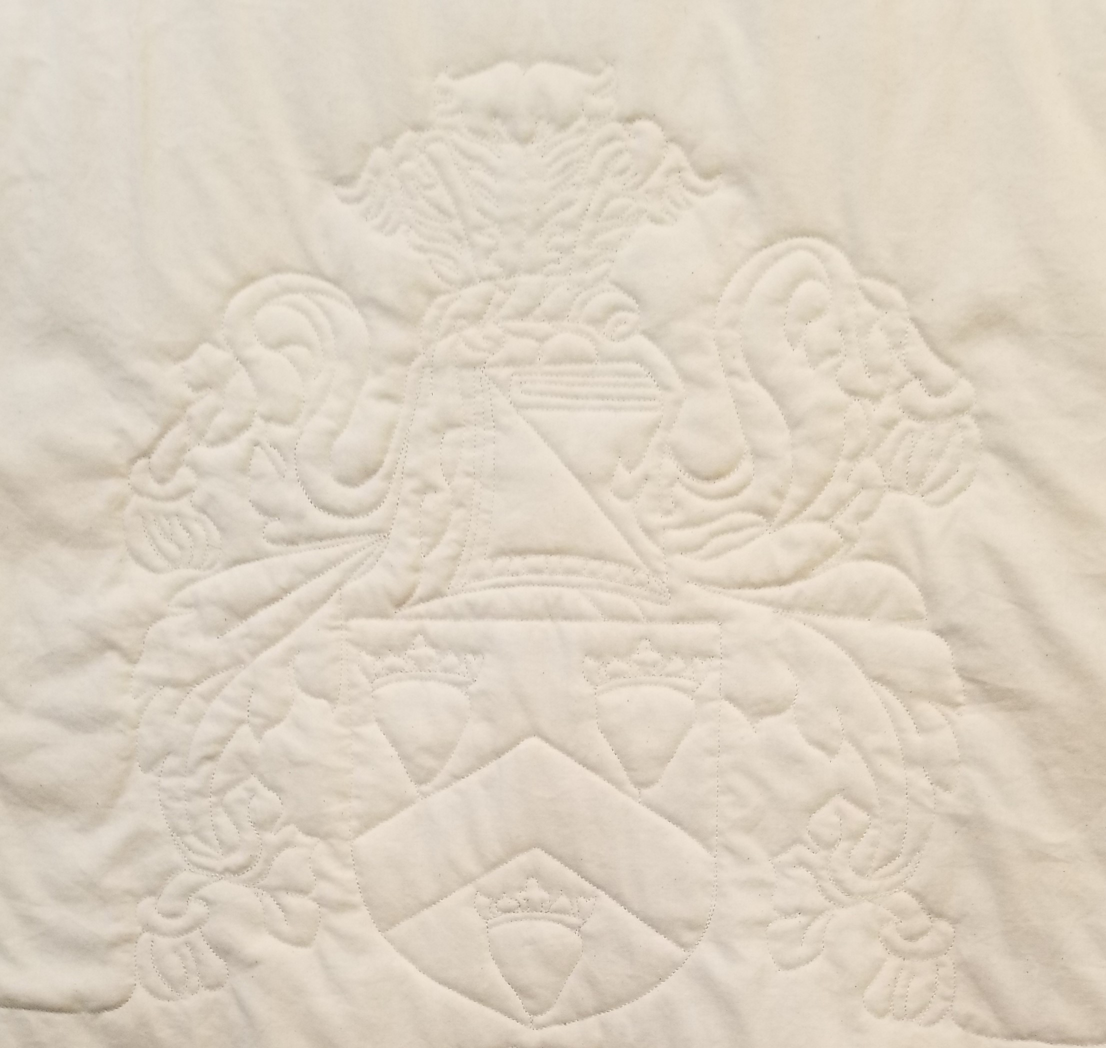 Beth's family crest replicated on her quilt.