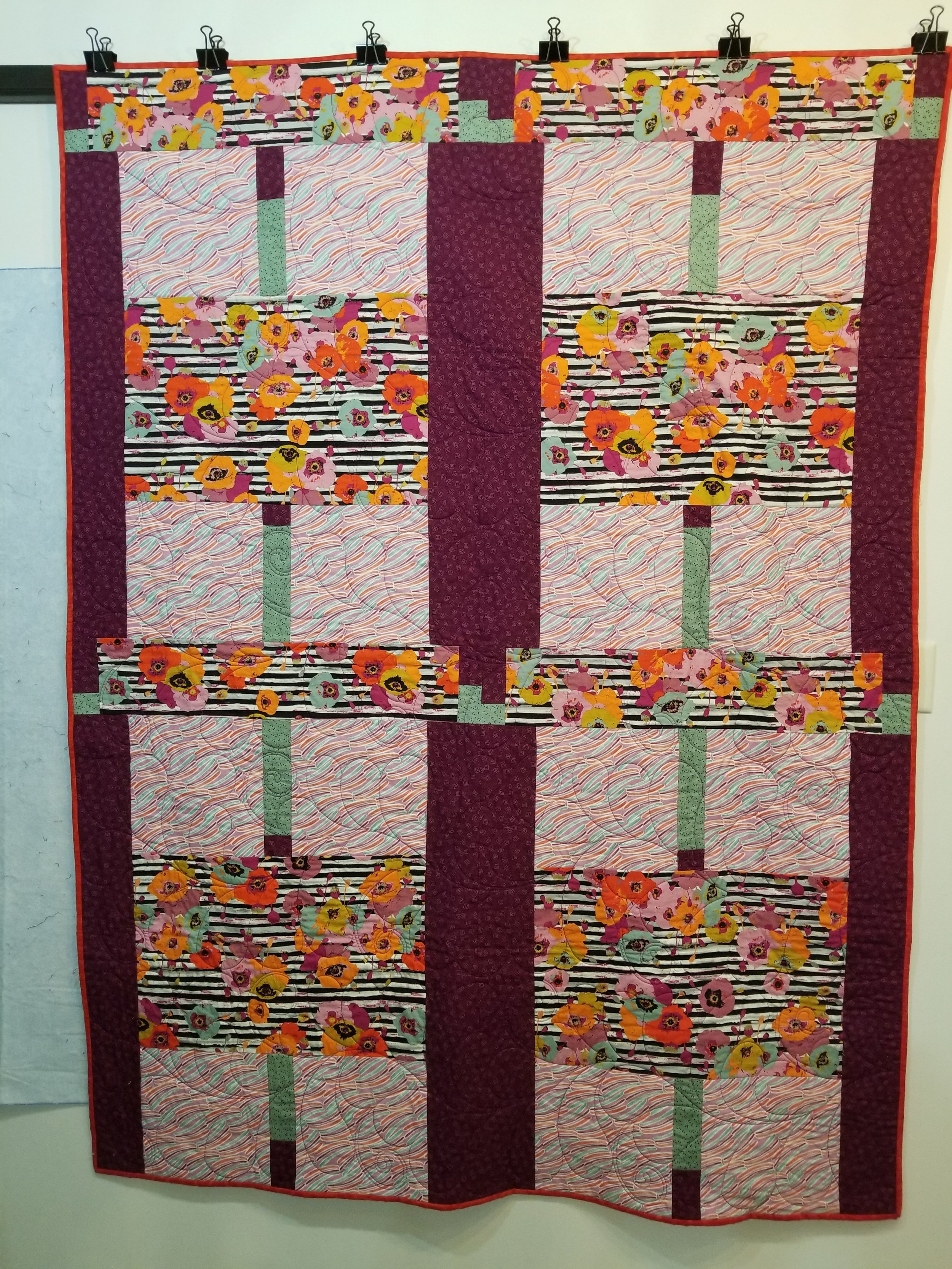 A bright binding was chosen to complement the quilt.
