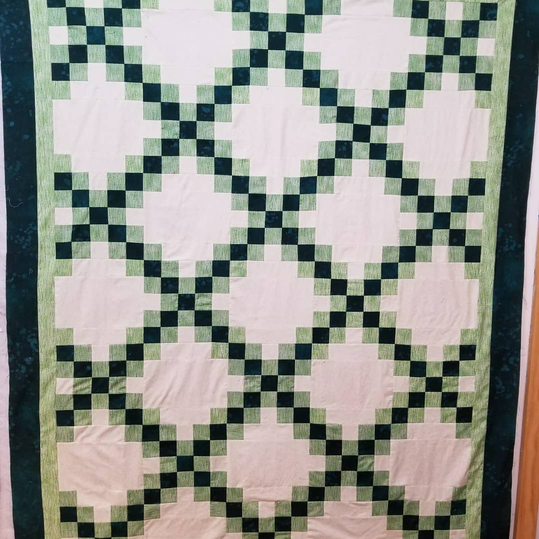 """The first block is defined by the strong """"X"""" that is created by two diagonal rows of squares running from corner to corner. The alternate block provides some negative offset to complete the design."""