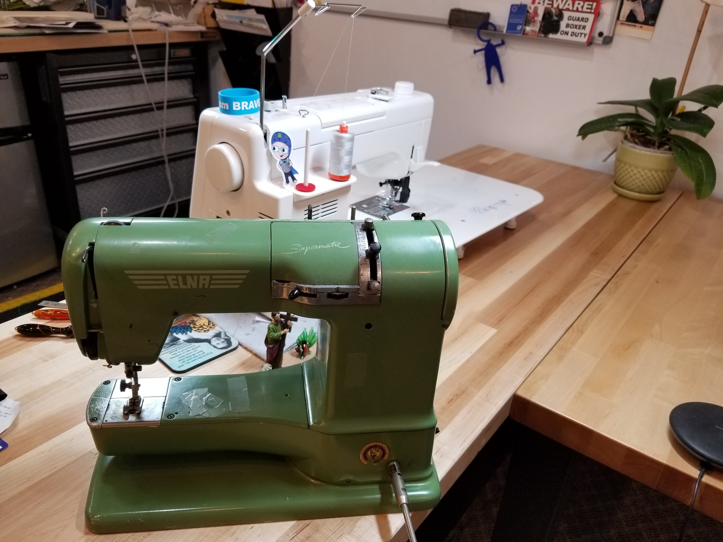 Above both models of Elna sewing machines.