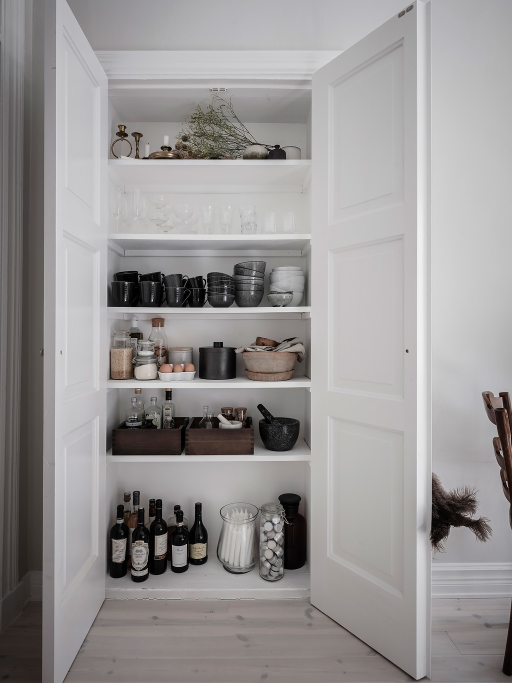 "Make the pantry feel ""fancy"" by corralling like items in containers and boxes."