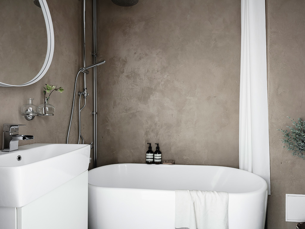 Consider rough plastered walls against a smooth modern tub or vanity.