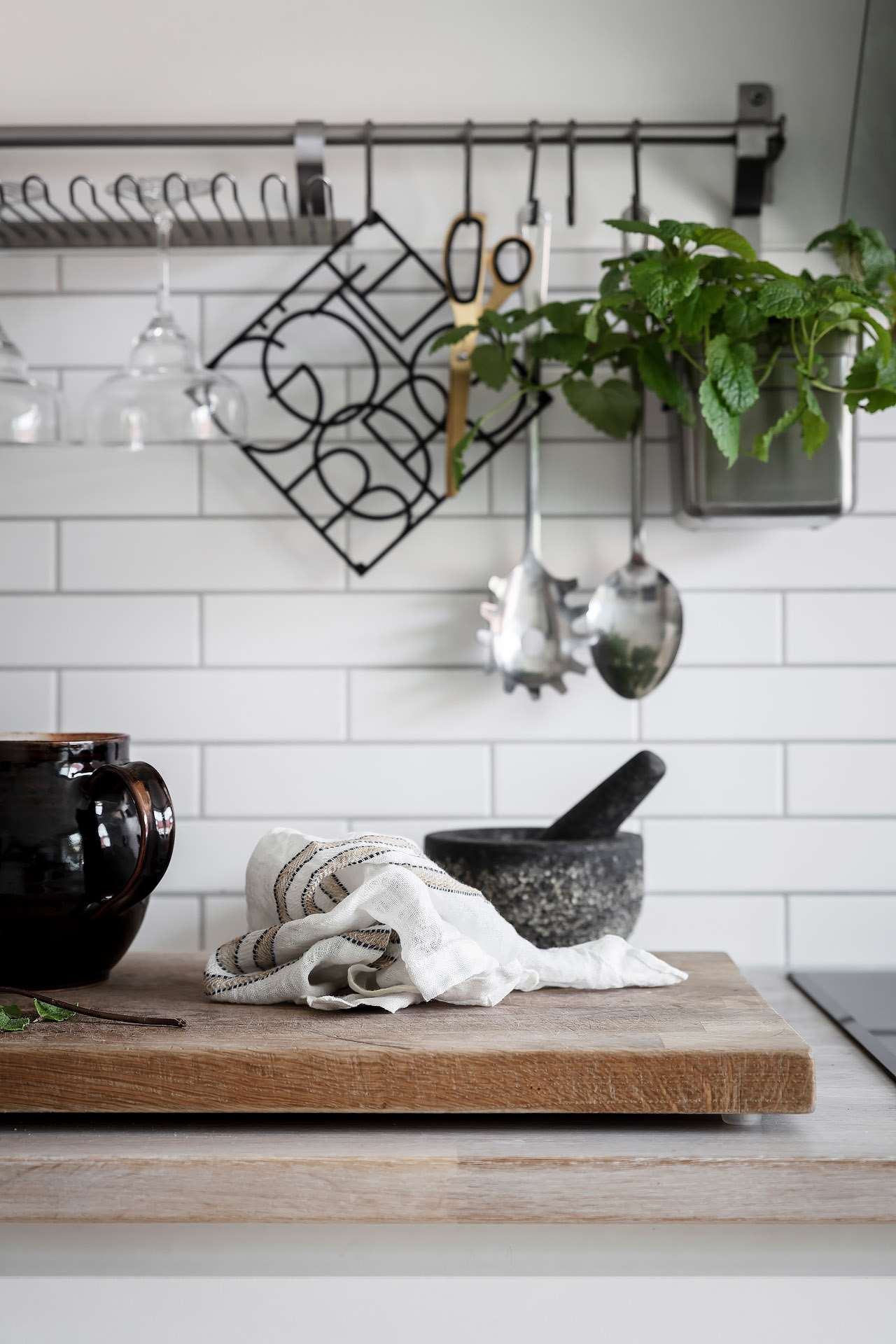 Blend Linen and stone against clean white subway tile