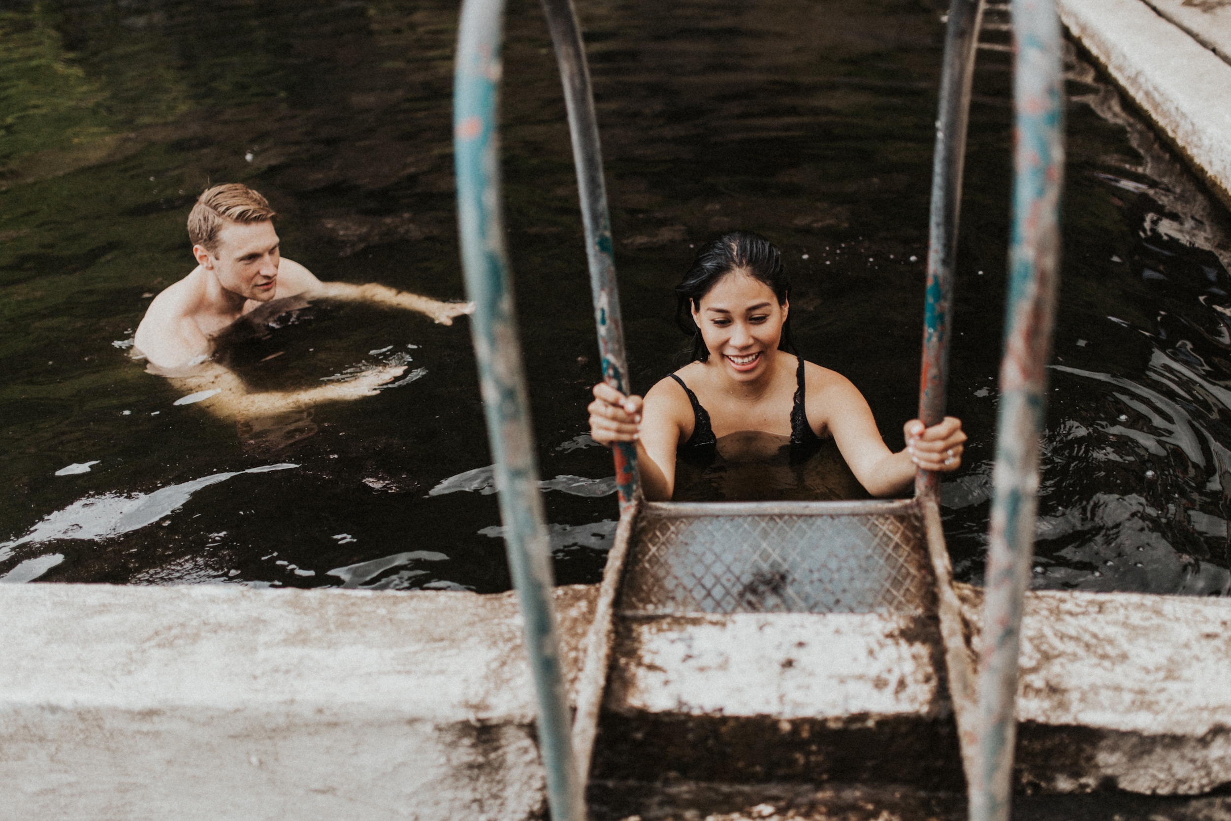 Couple climbing out of Seljavallalaug hot springs in Iceland.jpg
