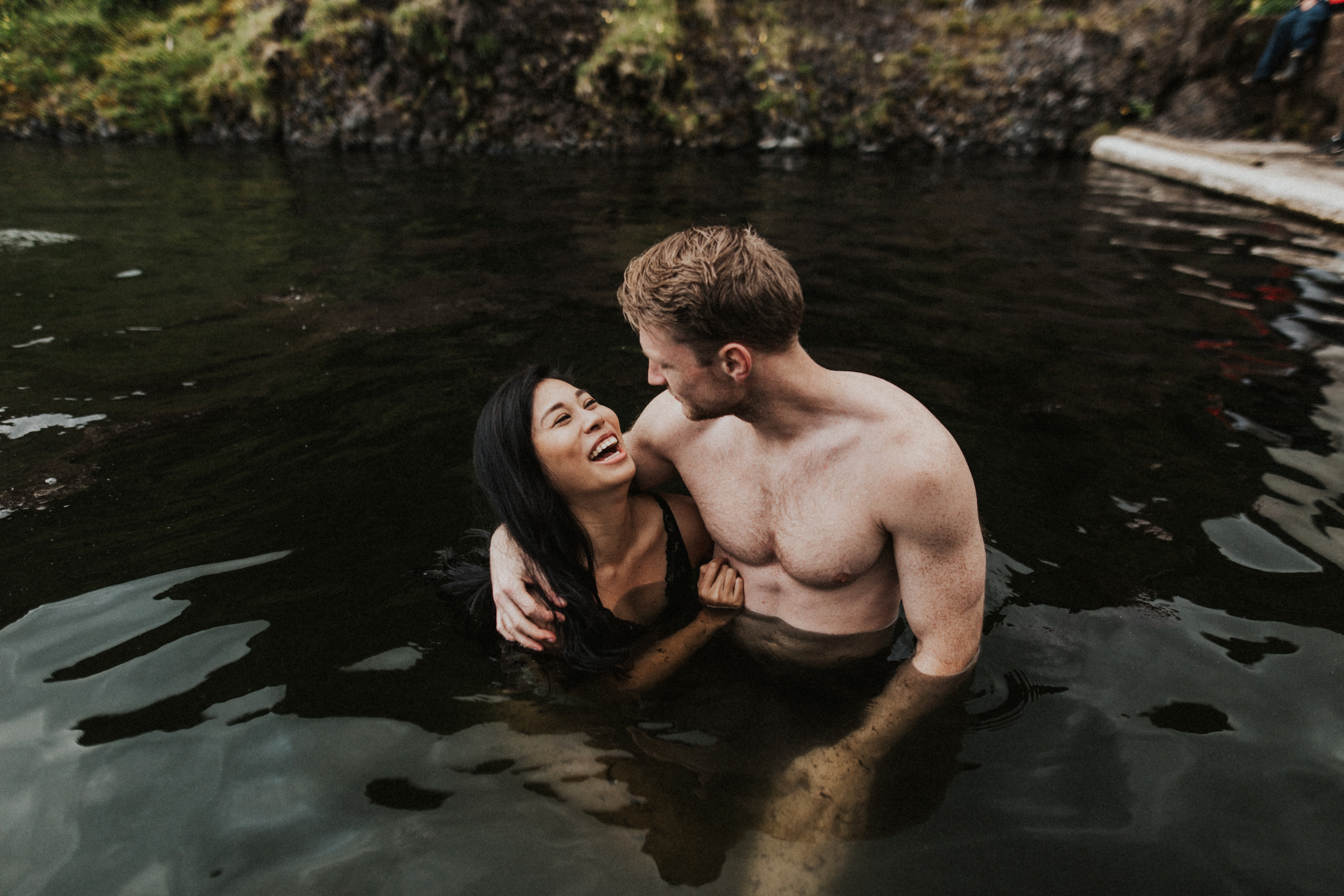 Laughing couple during photo session in Seljavallalaug hot springs in Iceland.jpg