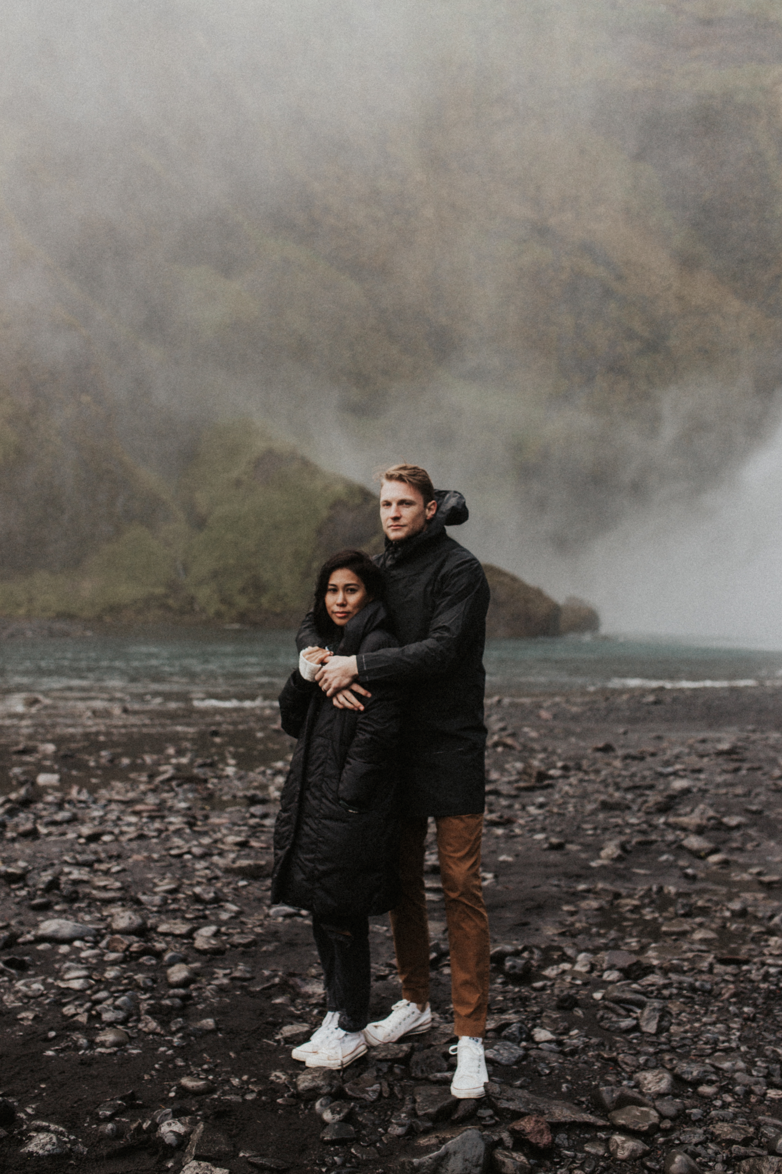 Stunning couples photography at Skógafoss waterfall in Iceland with mist and fog.jpg