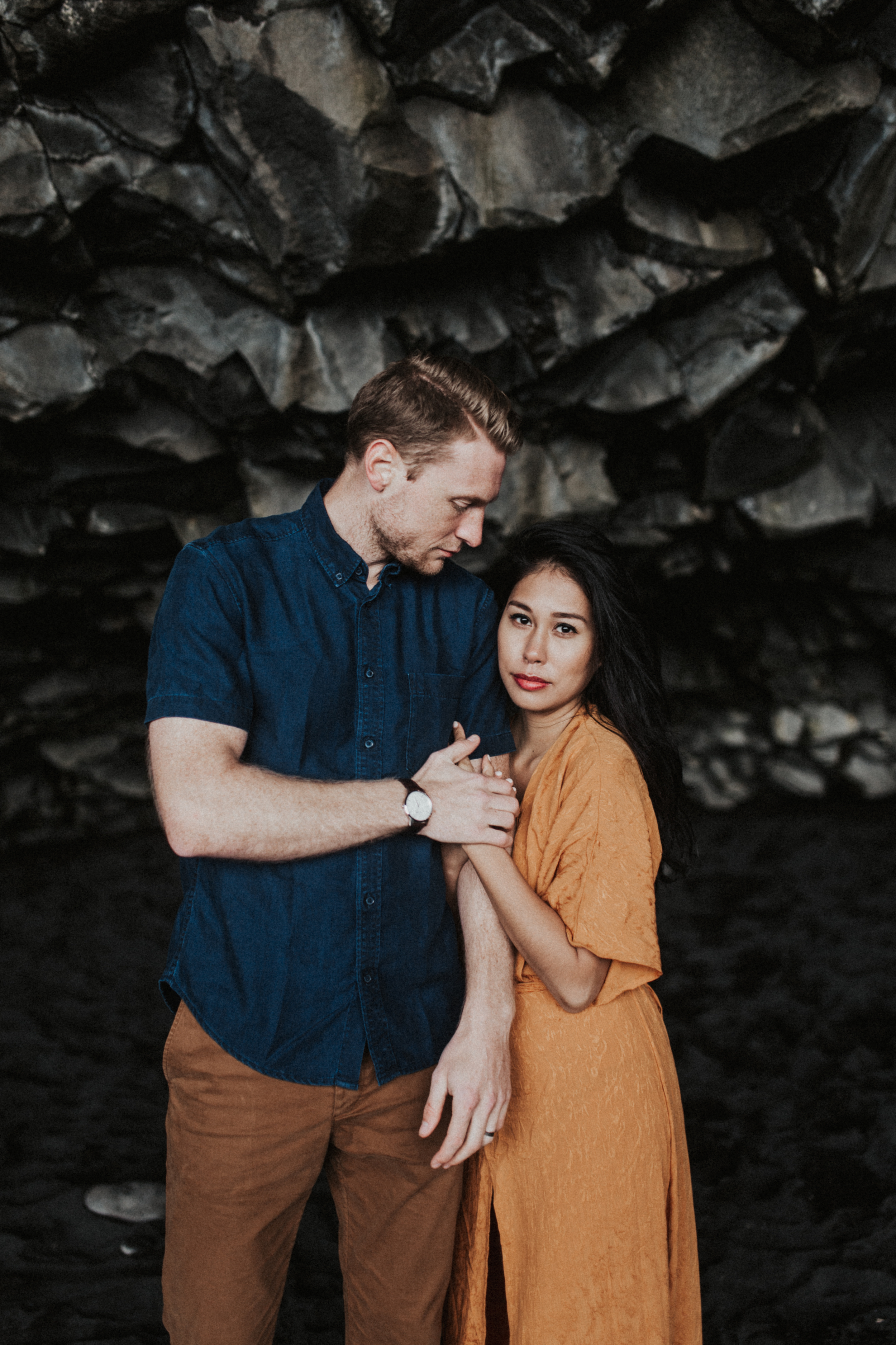 Stunning couple in orange and blue in Icelandic caves in Vik.jpg