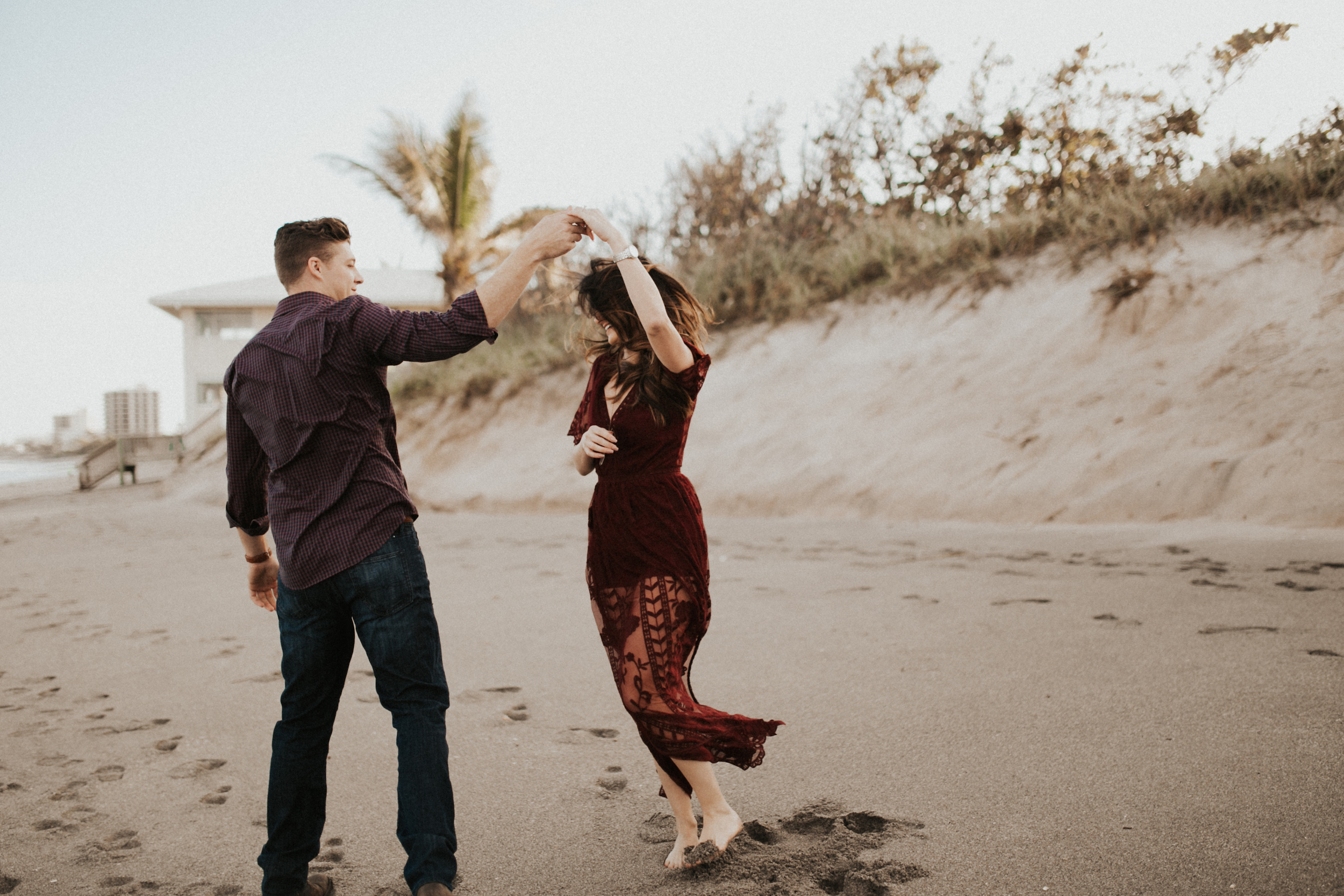 dancing on the florida beach in a red dress.jpg