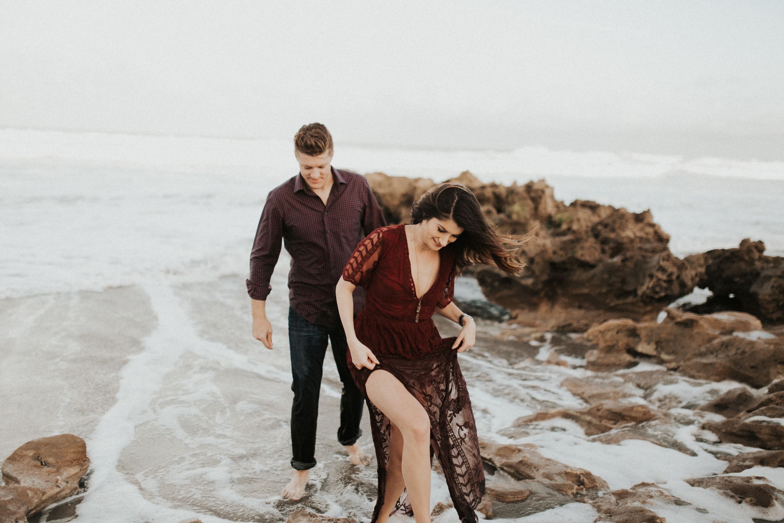 jupiter island engagement session with flowing dress in water.jpg