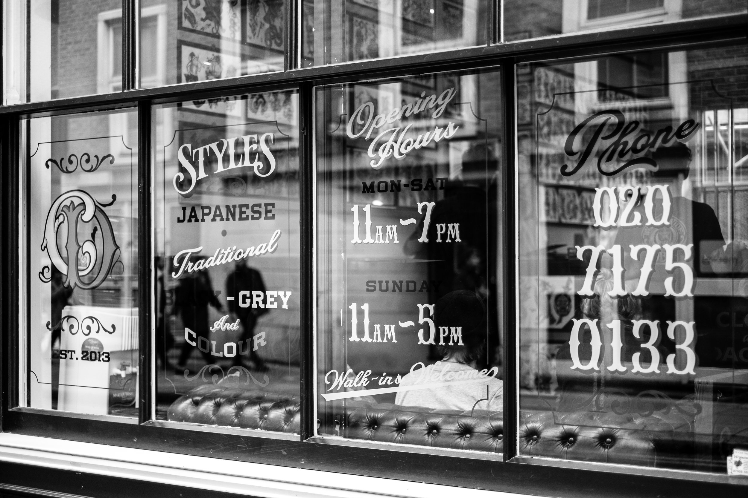 The shop window at American traditional tattoo shop,Cloak + Dagger.