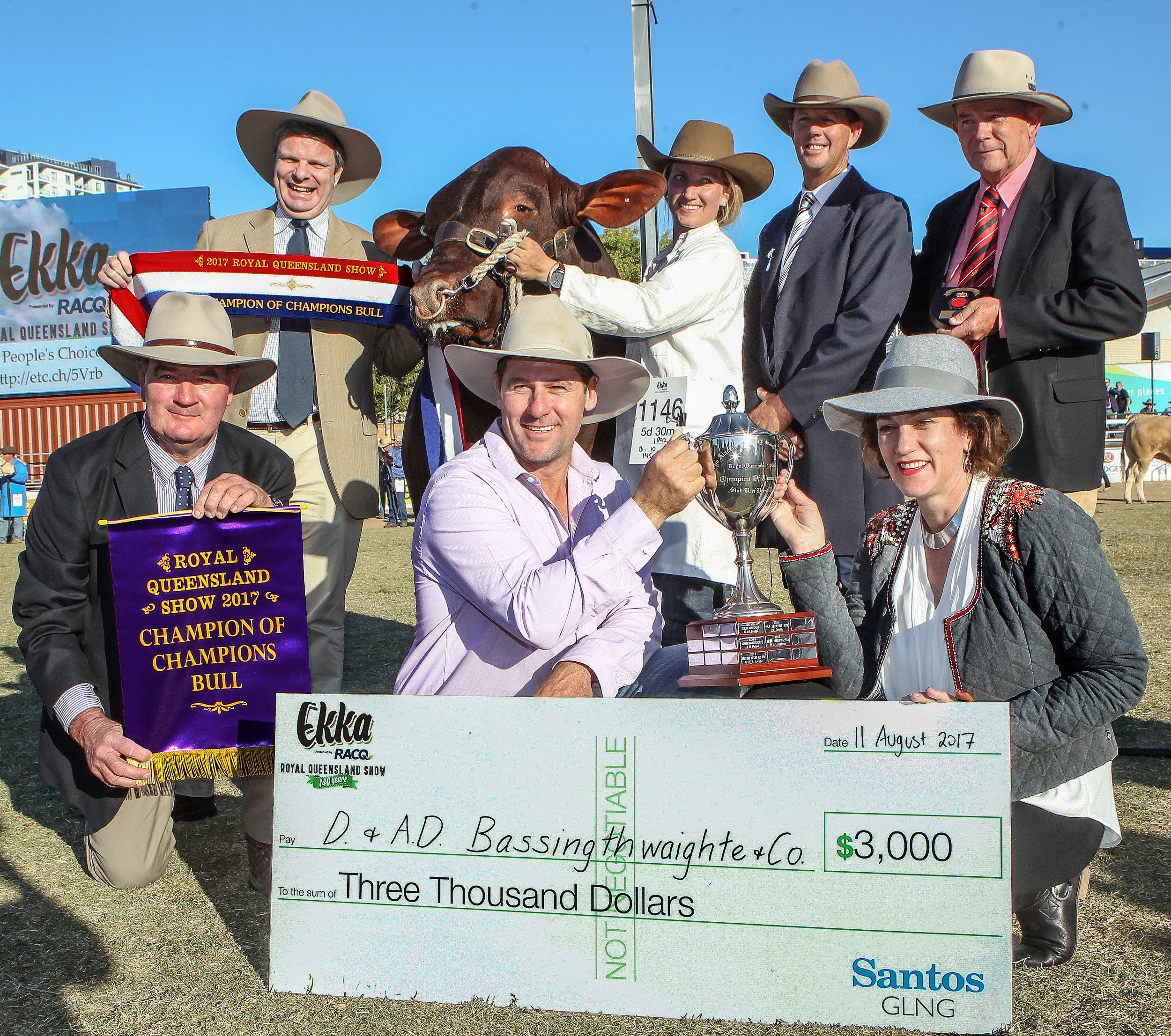 Yarrawonga Fixer L664 (P) awarded the Bassingthwaighte Family Trophy, Interbreed Champion of Champions, sponsored by Santos GLNG.  Alan Warby, RNA with Rod Duke from Santos, Parader Bridey Jonas with Judge, Brett Nobbs and Elders Representative Blake Munro, Exhibitor Andrew Bassingthwaighte and trophy presented by Wendy Ferguson.