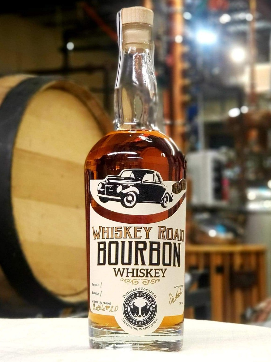 Whiskey Road Bourbon - (Currently out of stock)80 Proof / 750 mlIntroducing our first aged spirit! This whiskey was made in 2015 and set aside in brand new charred white oak casks for 3 years. We use a blend of Washington grown corn, white wheat, malted barley, and a little bit of rye and peated malt. It was distilled low and slow in our 100-gallon copper pot still. The result has been as smooth as it is flavorful, with delicious notes of caramel, vanilla, oak and maple, with a peppery finish.You'll want to sip this neat. Or try it in an Old Fashioned or a Manhattan.