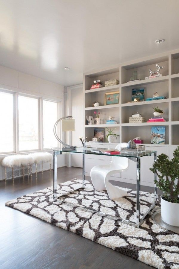 This giraffe print rug by the  Kiara Shag Collection  really makes sense under this glass desk.