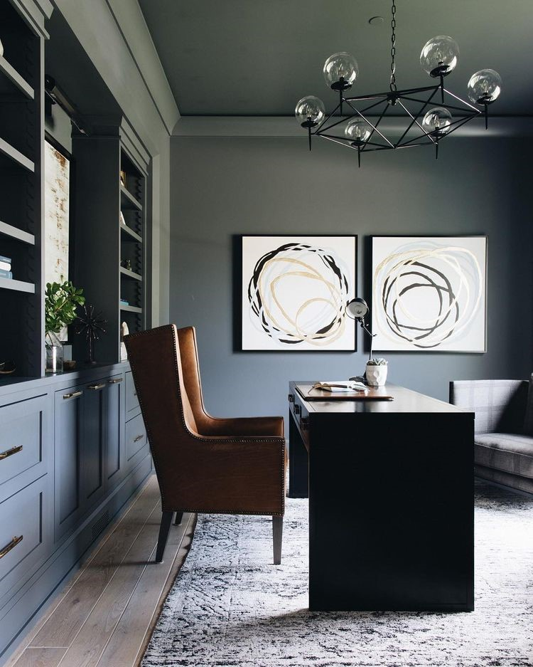 Grand Tradition Homes utilized modern accents in this masculine space.