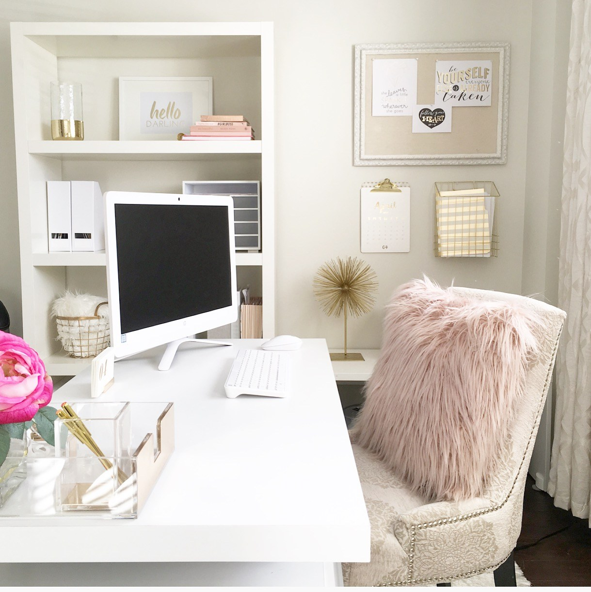 I love the feminine touches of pink that  Interior Love Affair  used for their home office.