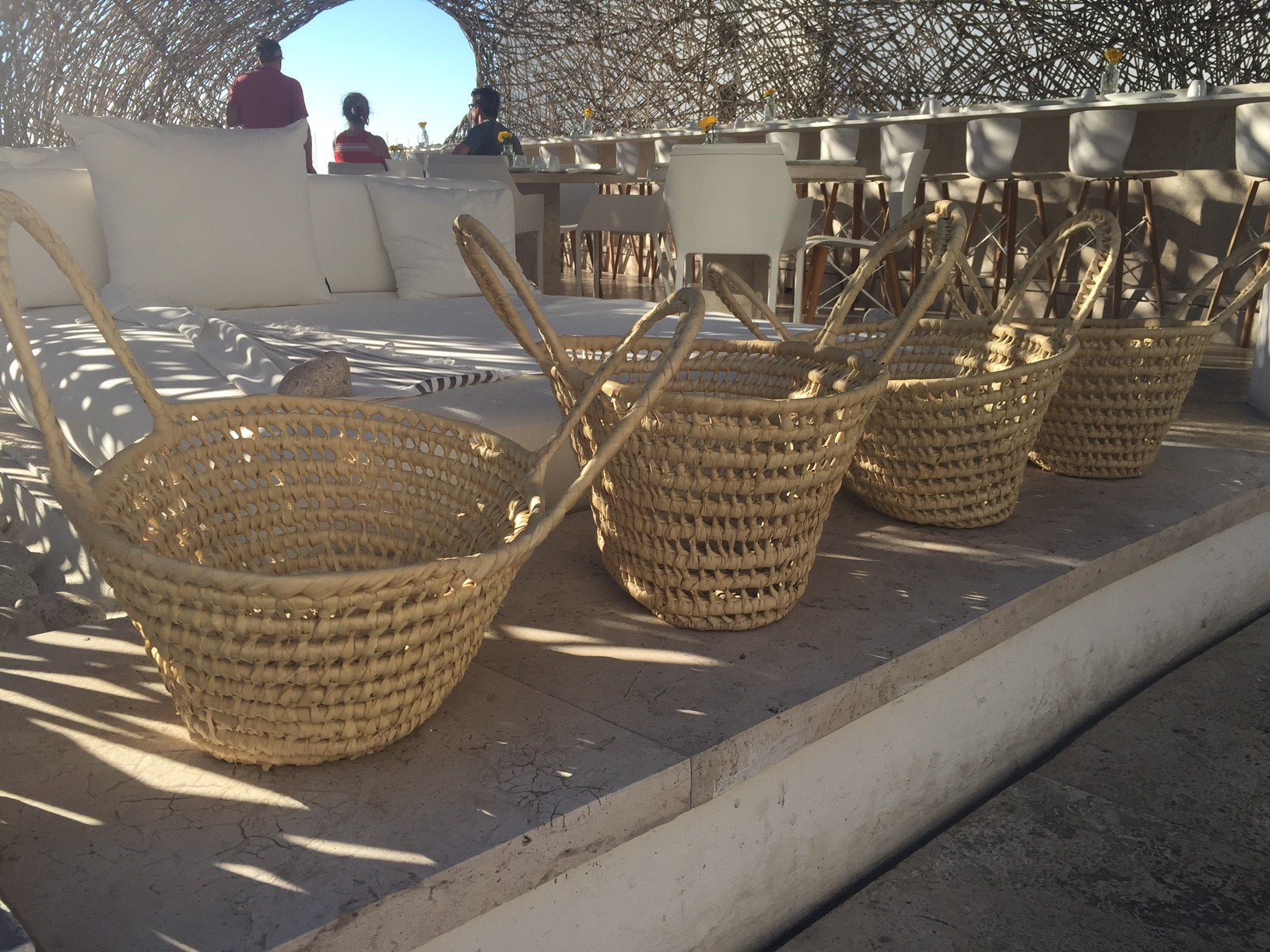 Inside the restaurant, artisan baskets line up mimicking the architecture.