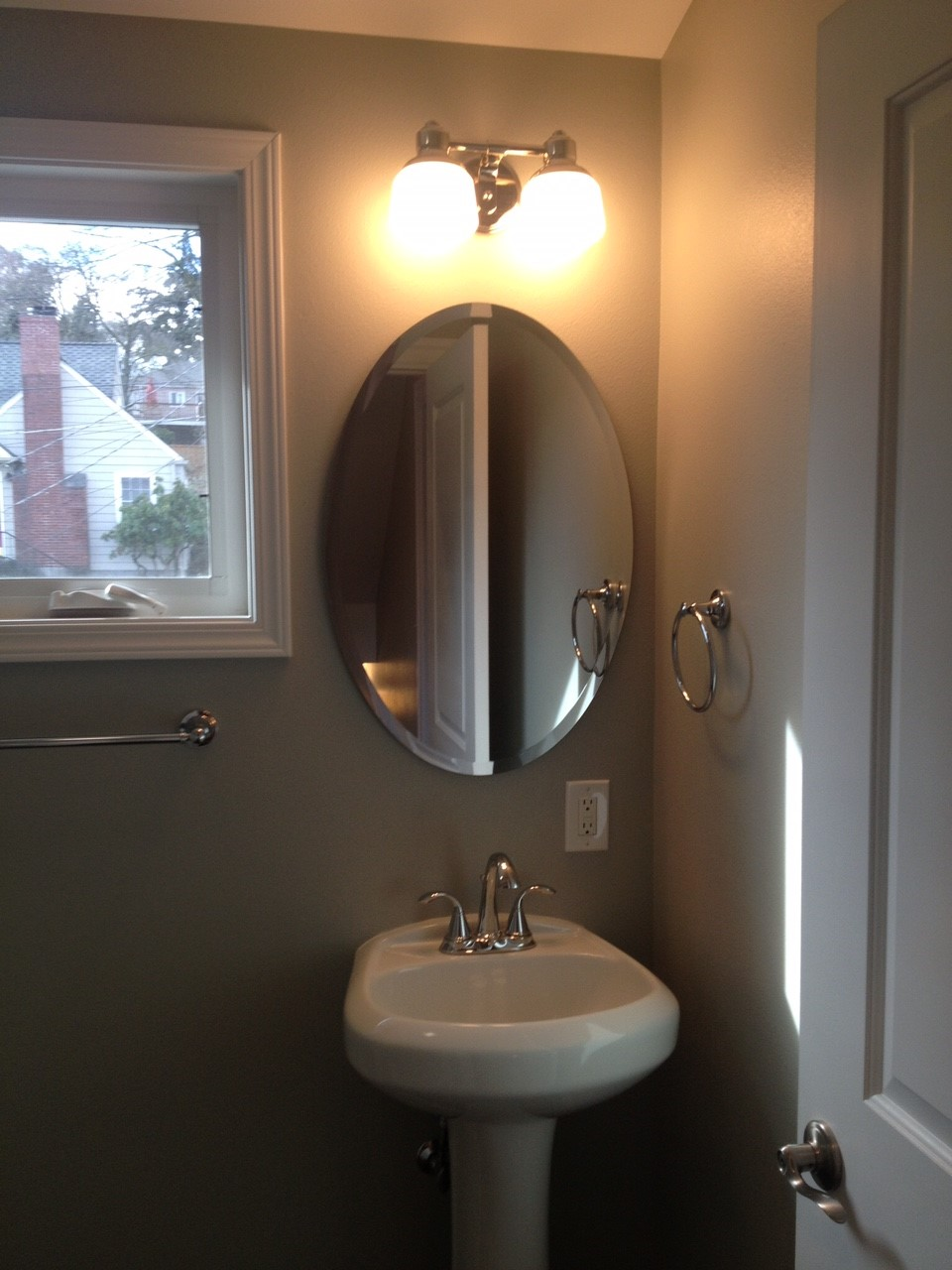 After: Use appropriate sized pieces, like this sweet vanity, to finish a much needed bathroom