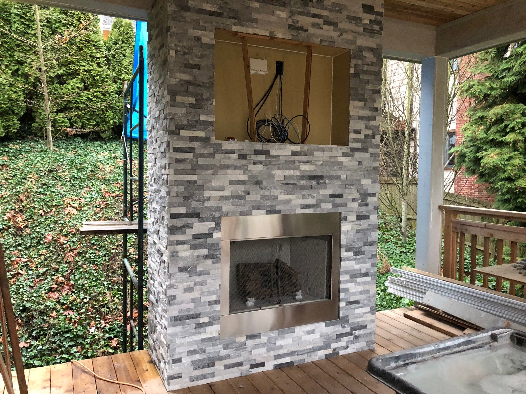 Once this fireplace with tile from  Home Depot  was finished, we were ready to MOVE IN!