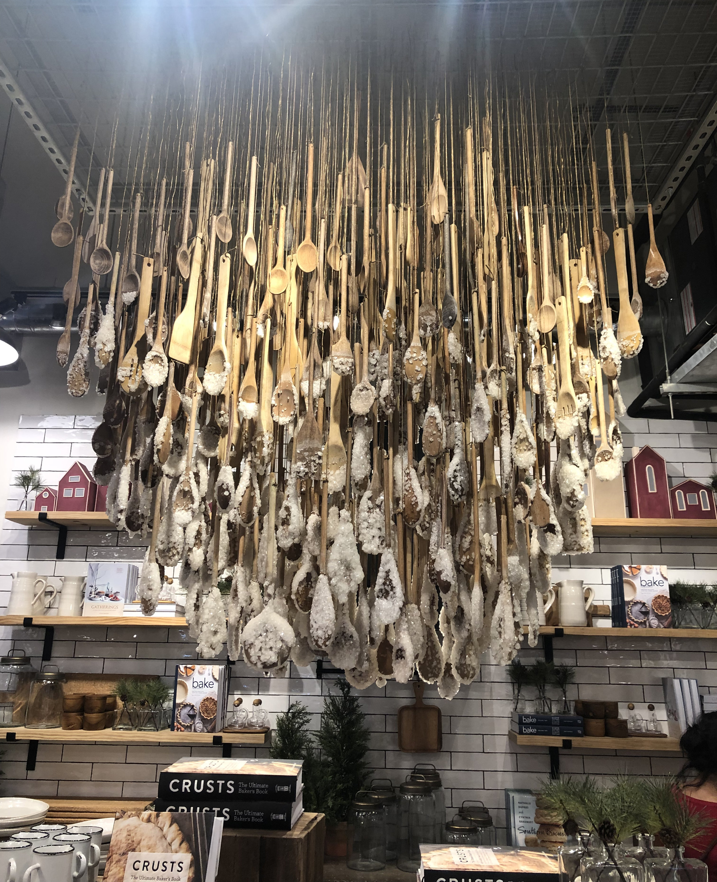 """Check out this super cool """"chandelier"""" made out of sugared, wooden spoons and spatulas."""