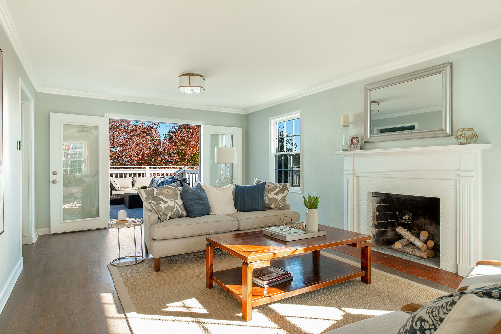 French doors to the deck provide beautiful light in the living area.