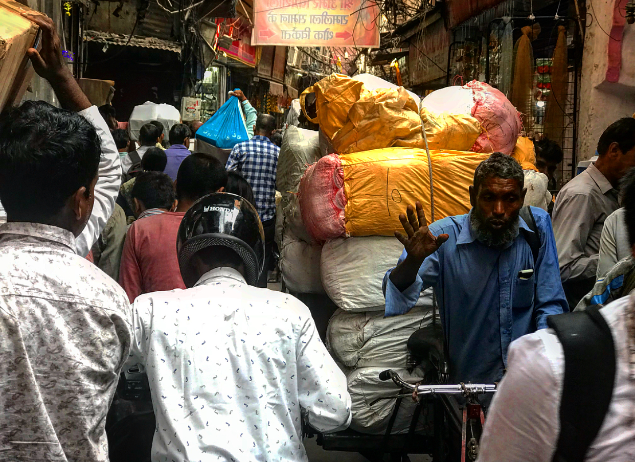 Everyone and everything trying to squeeze through the narrow streets of Old Delhi.