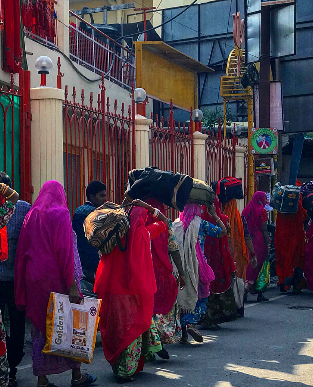 The Indian women of Rishikesh and the art of balancing bags.