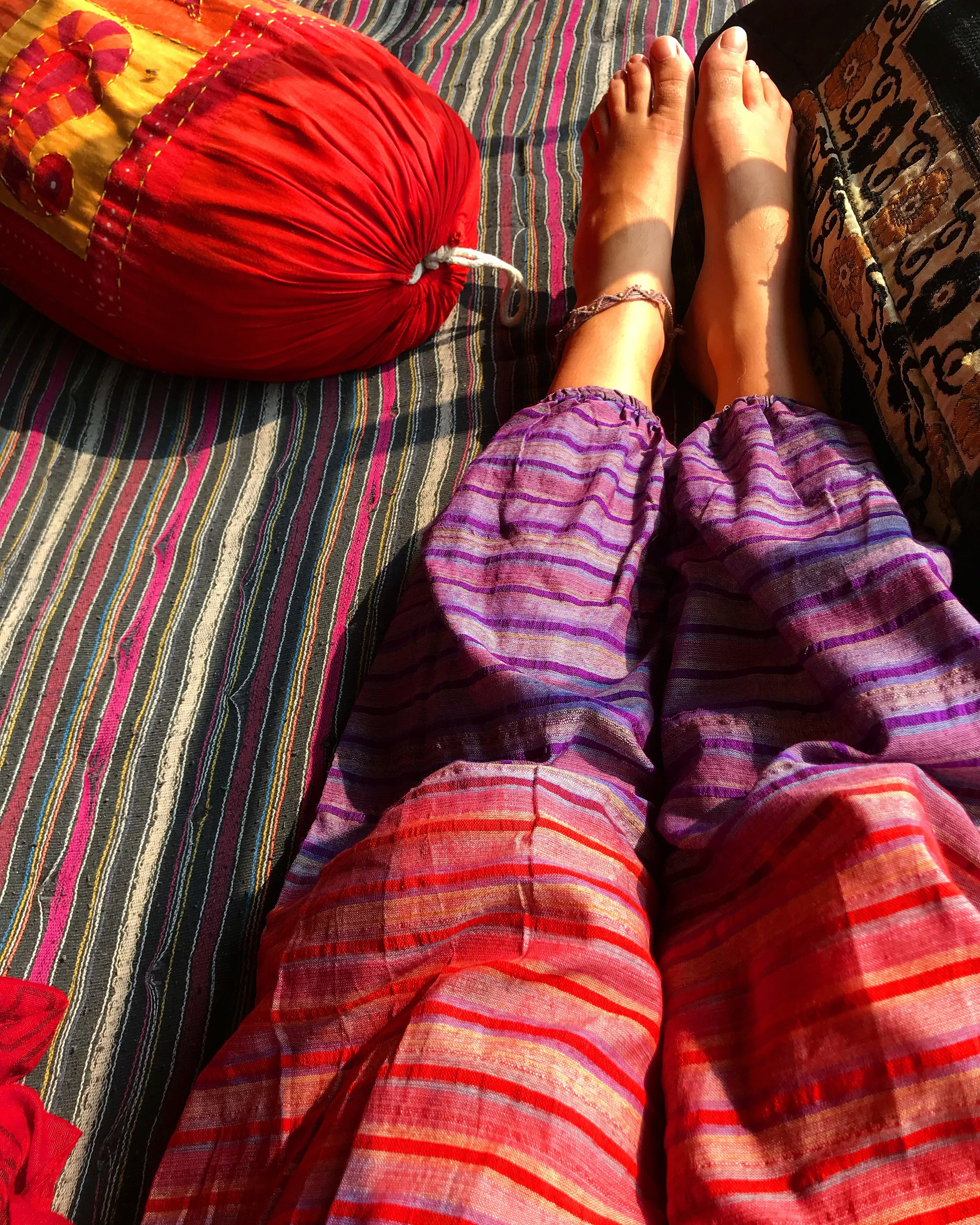My funky pants matching the boho style blankets at Shambala Cafe.