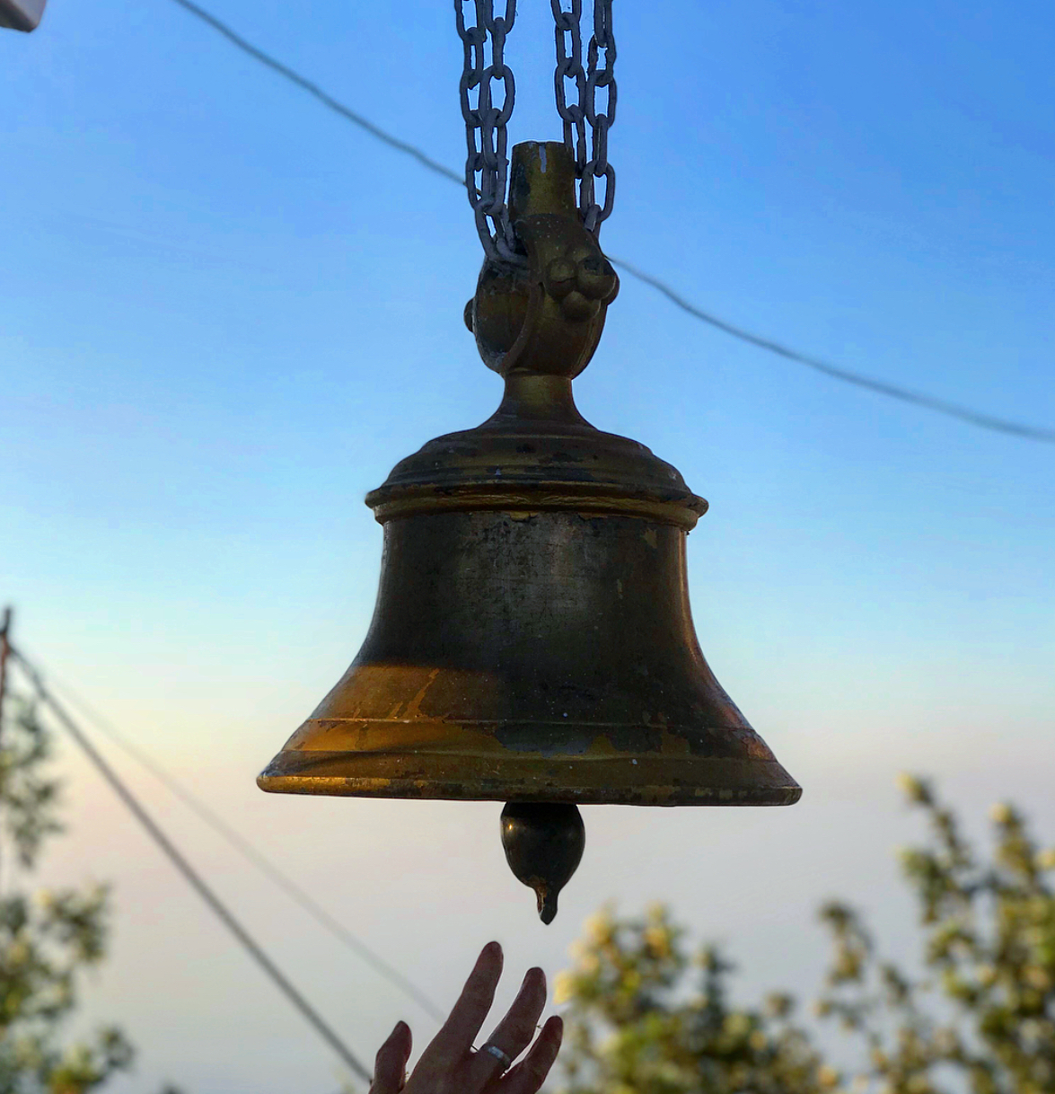 Sounding the temple bell.