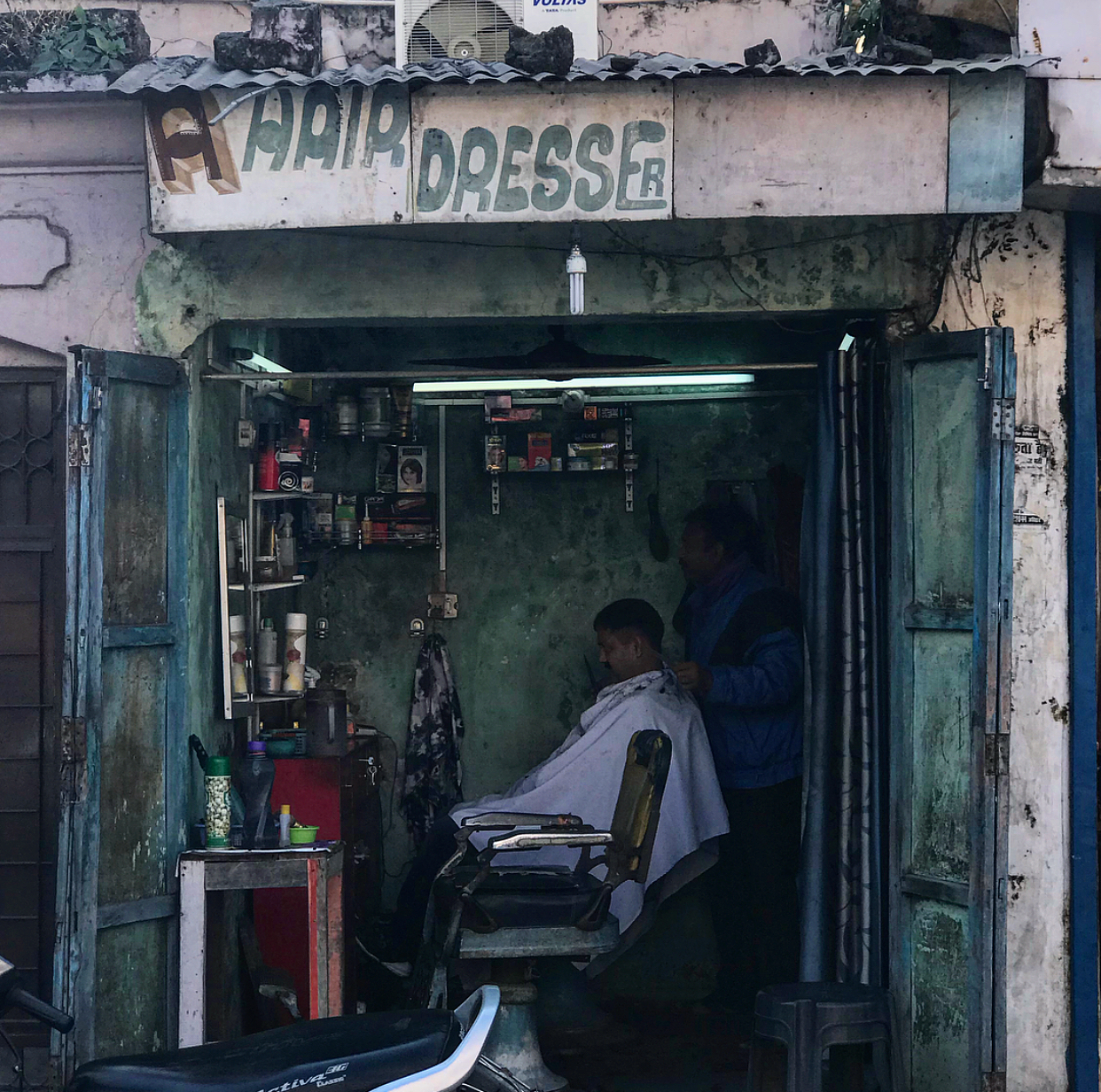 This is what the hairdressers/barbers look like here in India. It's crazy how much we take for granted in the West.