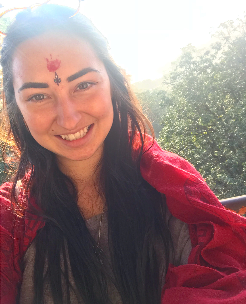 Blessed at the temple, represented by the red mark on the forehead (the third eye chakra).