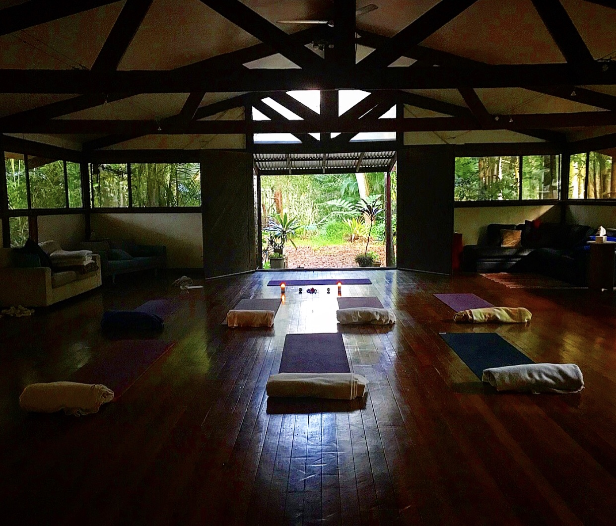 The beautiful yoga hall surrounded by nature.