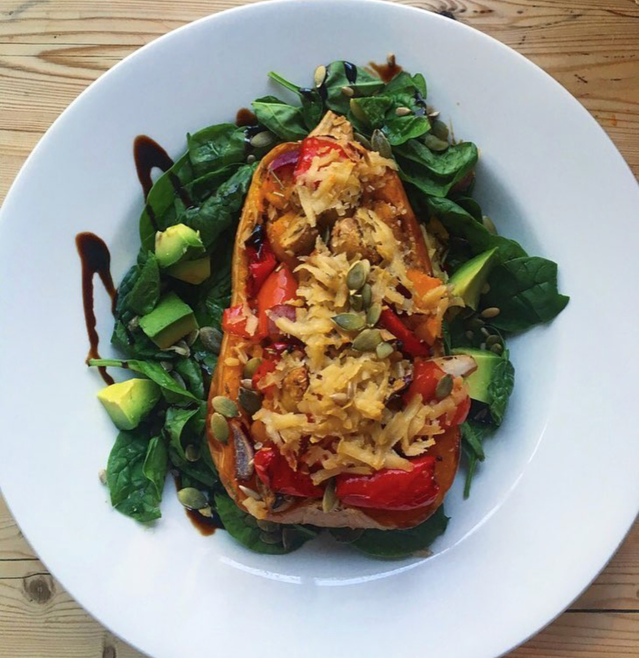 Roasted butternut squash with quinoa, pepper, avo & vegan cheese.