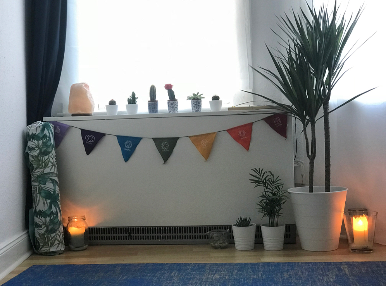 The beautiful yoga space I've created in our bedroom.