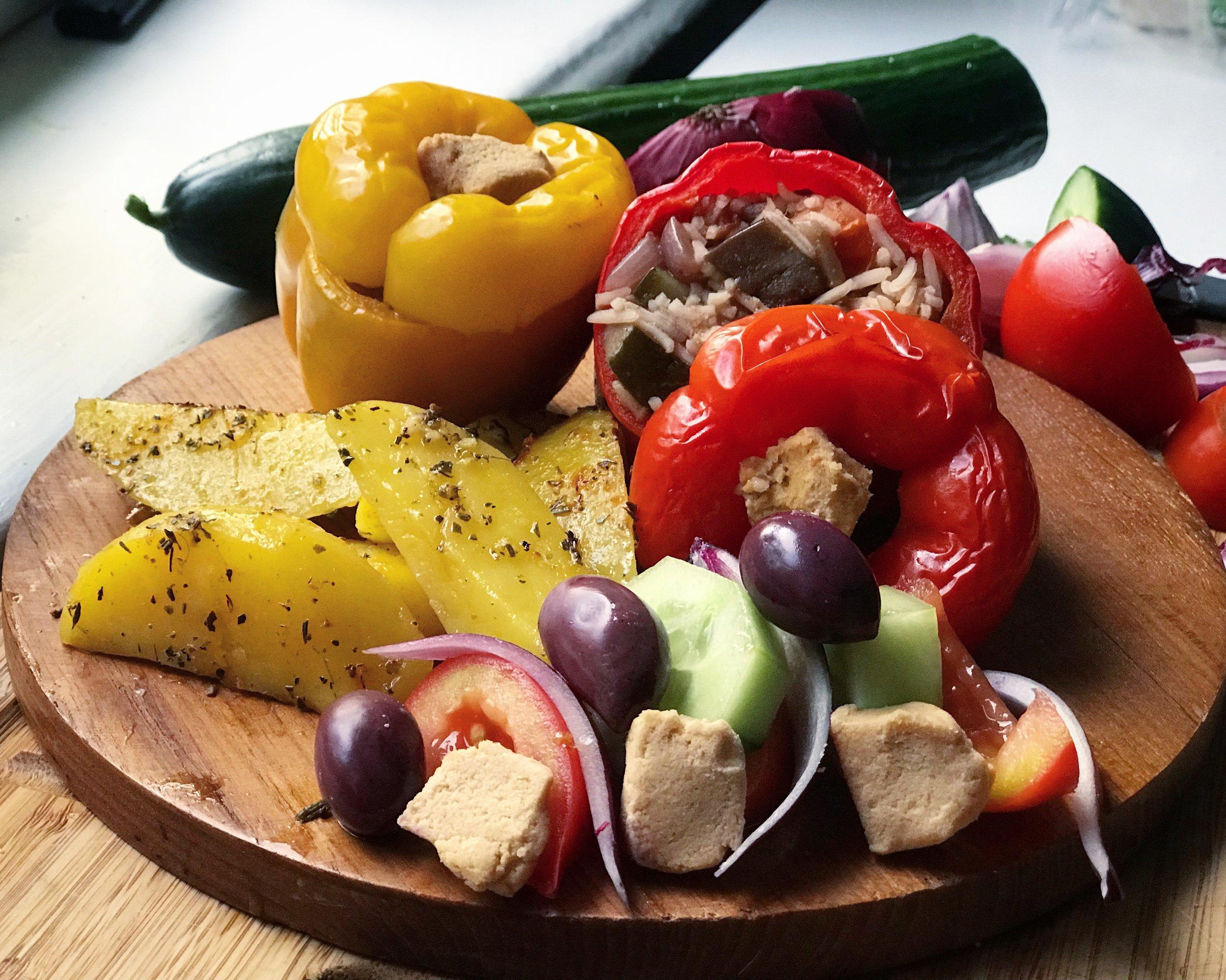 Greek Night's main meal of stuffed peppers, homemade vegan feta cheese and Greek style potatoes.