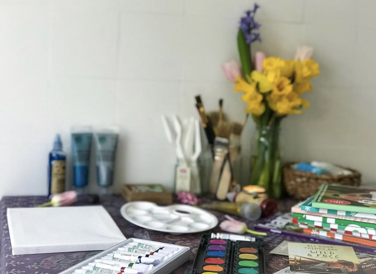 Setting up an art space in our kitchen. (Making it look pretty to invite the creativity in.. if you haven't read Big Magic, I highly recommend it)!