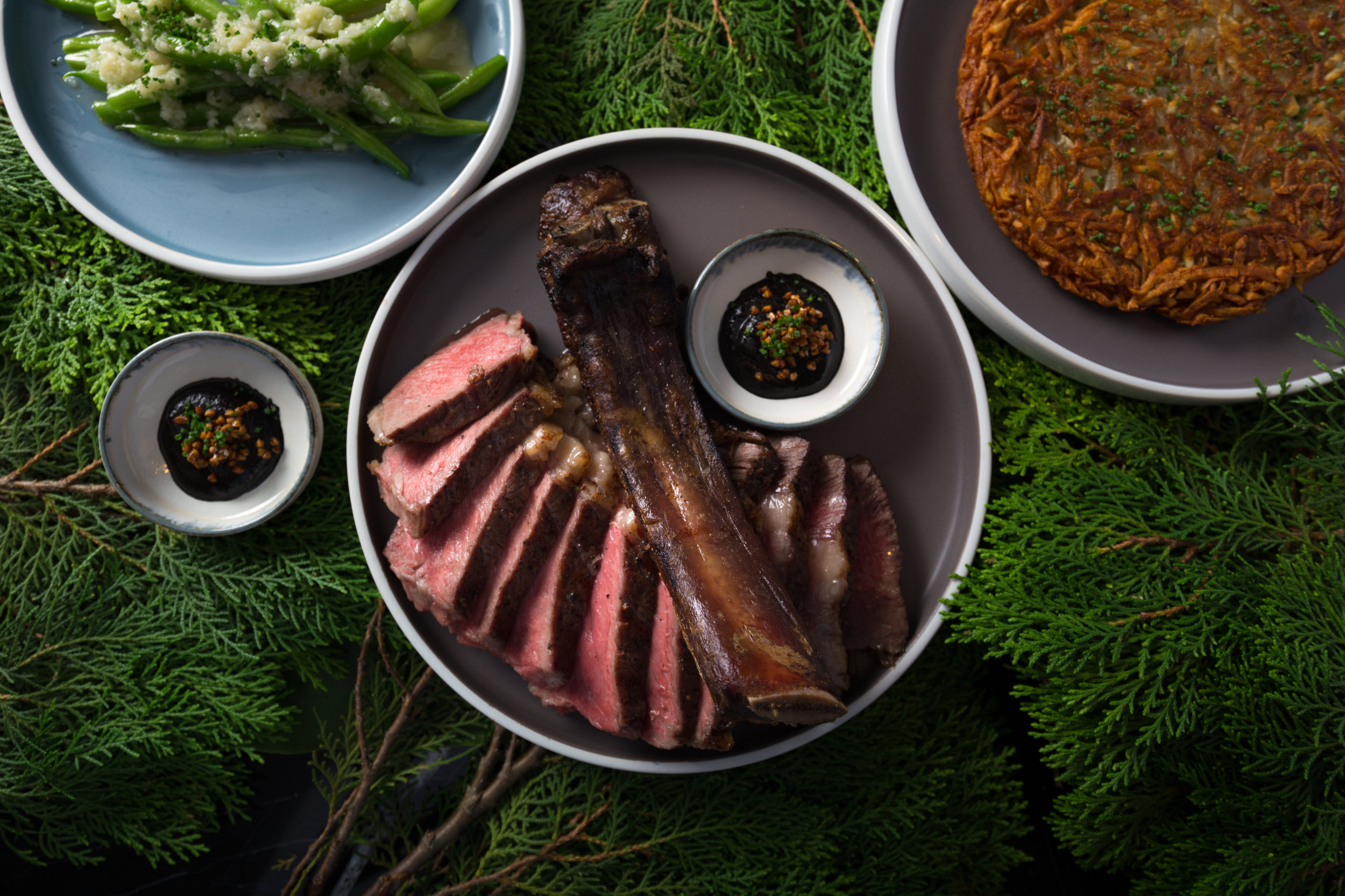 DRY-AGED PRIME RIB - 45-day dry-aged U.S. cote de boeuf, rosti wih katsuobushi, vegetables, 90-day housemade black garlic900g-1.4 kg, for 2-4 guests to share18.8/100g