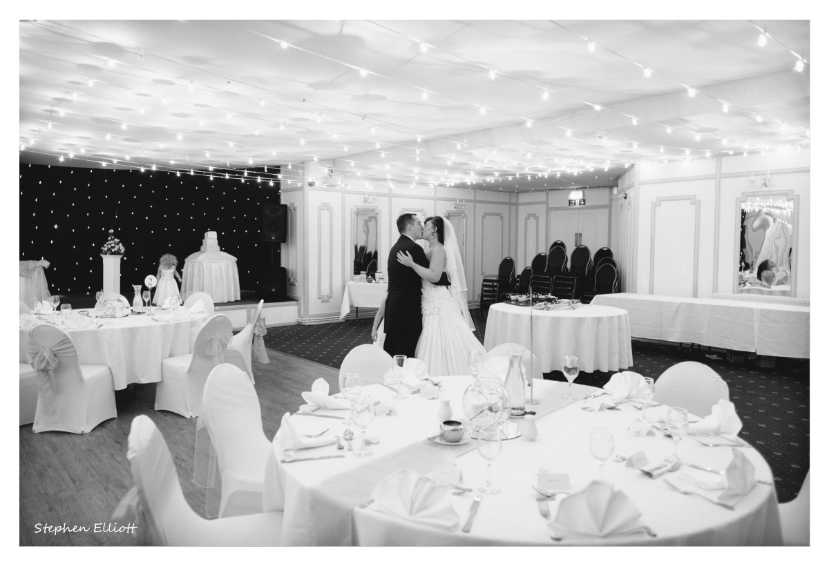 bride_groom_reception_kiss.jpg
