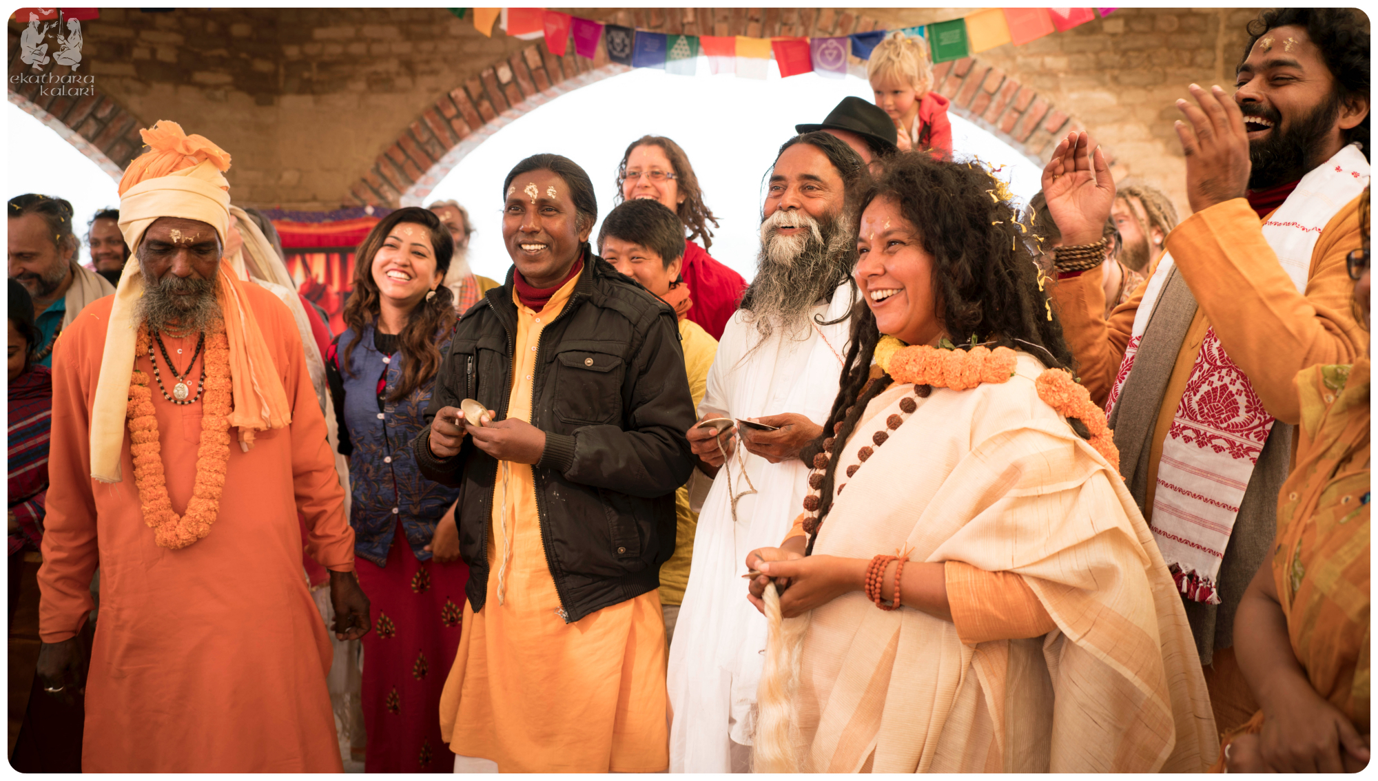 Our dear teacher Parvathy Ma surrounded by Baul masters and new friends singing to Radha Krishna.