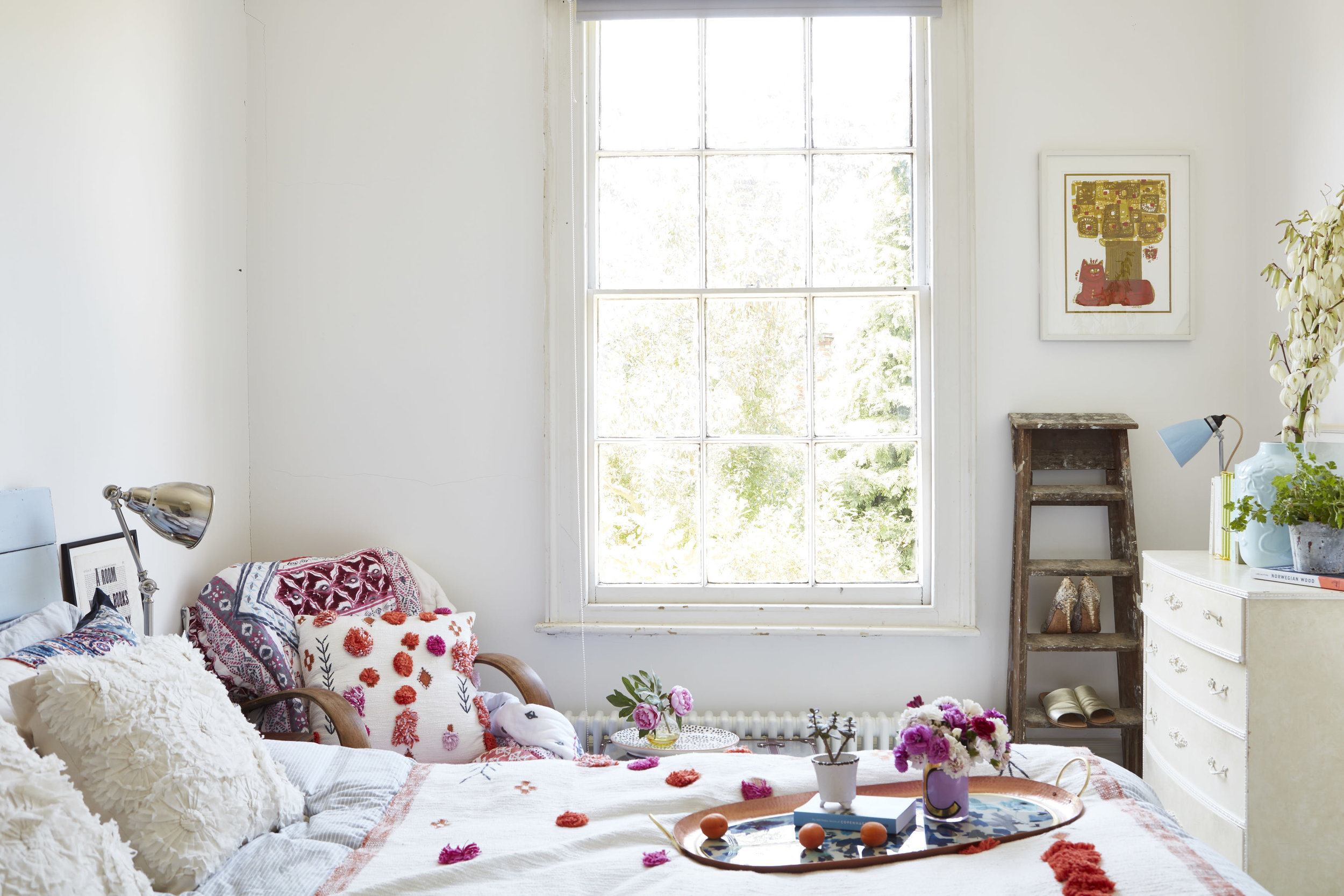 Linen, all Neptune. Lamp,  Ikea.  Cup,  Anthropologie . Headboard painted in Bluebell by  Bert and May.  Quilt, cushions and throws, all Anthropologie. Walls are painted in Strong White by  Farrow and Ball.